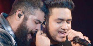 Henrique e Juliano cantando